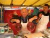 market trader shows off his tuna steaks