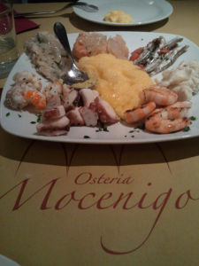 a seafood platter with polenta served at the Osteria Mocenigo