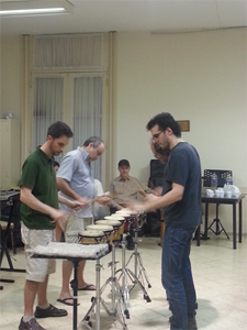 Members of Ensamble Perceum rehearse Drumming with Steve Reich looking on